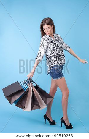 Beautiful young girl is going shopping with joy