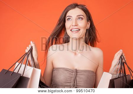 Beautiful young woman is buying things with pleasure