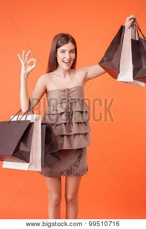 Pretty young woman is boasting of her purchase