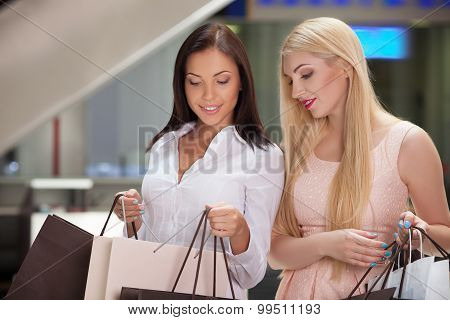 Pretty young women are going shopping together