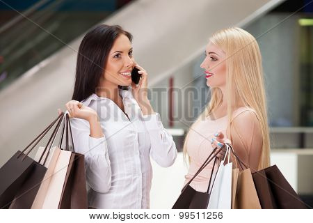 Beautiful young women are going shopping with joy