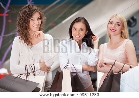 Attractive young girls are buying clothing in boutique