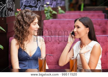 Cheerful young women are resting in cafe