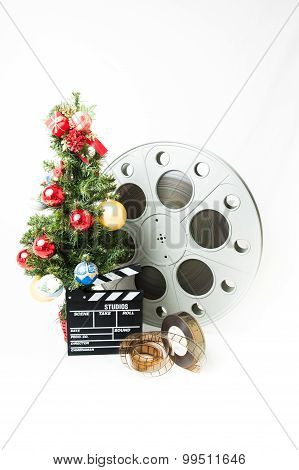 Christmas Tree With Big Cinema Reel And Movie Clapperboard