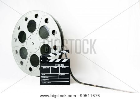 35Mm Cinema Big Reel With Film And Movie Clapperboard