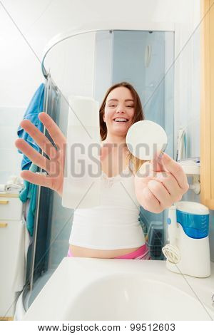 Woman Removing Makeup With Cotton Swab Pad.