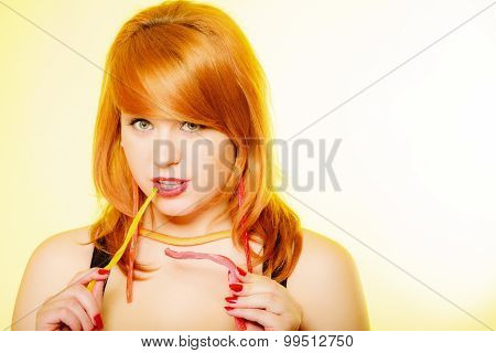 Redhair Girl Holding Sweet Food Jelly Candy On Yellow.