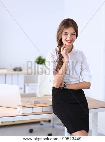 Attractive businesswoman standing in office