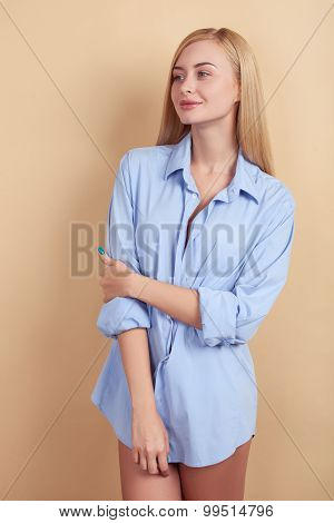 Cheerful young blond girl is resting in morning