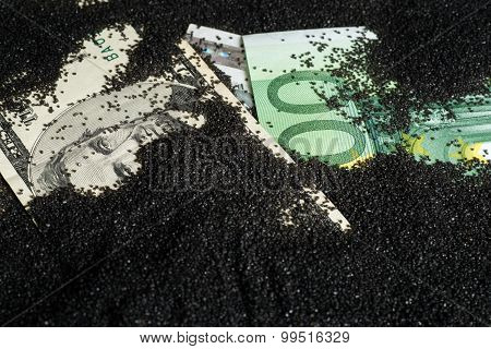 Banknotes Covered With Black Sand