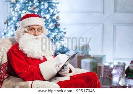 Friendly Santa Claus is preparing for greeting people
