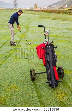 Wheeled Golf Bag And Golf Player