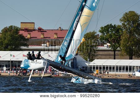 ST. PETERSBURG, RUSSIA - AUGUST 20, 2015: Catamaran of Oman Air sailing team during the 1st day of St. Petersburg stage of Extreme Sailing Series. Red Bull Sailing Team of Austria won the day