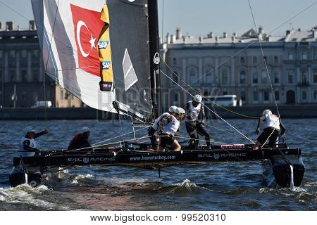 ST. PETERSBURG, RUSSIA - AUGUST 21, 2015: Catamaran of Team Turx of Turkey during 2nd day of St. Petersburg stage of Extreme Sailing Series. Red Bull Sailing Team of Austria leading after the 1st day