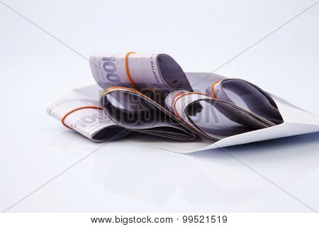 malaysia ringgit in a envelope
