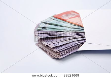 Malaysia rinngit in a white envelope