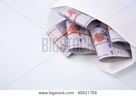 malaysia currency in a white envelope
