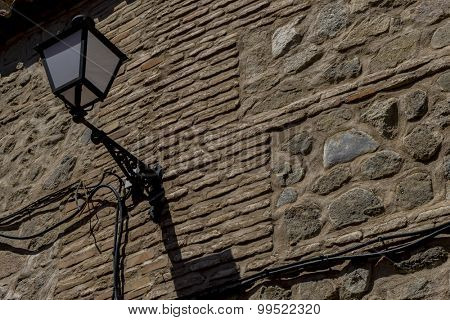 Lamp, streets of the city Toledo, medieval architecture and Castilian