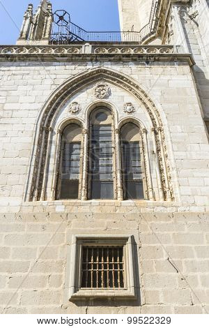 Medieval window, majestic facade of the cathedral of Toledo in Spain, beautiful church