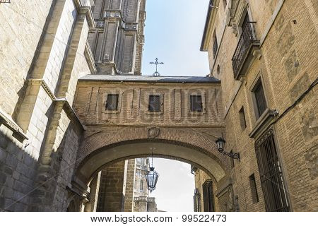 Street, majestic facade of the cathedral of Toledo in Spain, beautiful church