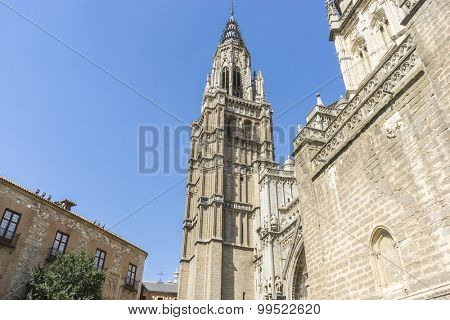 Bell tower, majestic facade of the cathedral of Toledo in Spain, beautiful church