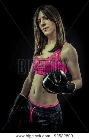 Sport, strong woman athlete with boxing gloves