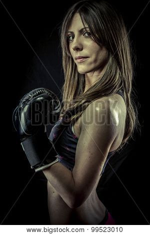 Fighter, strong woman athlete with boxing gloves