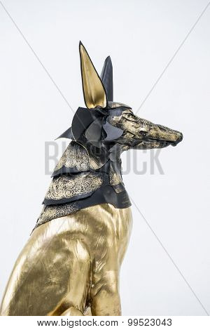 Treasure, sculpture of the Egyptian god Anubis, gold figure and black jackal