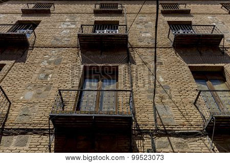 Balconies, streets of the city Toledo, medieval architecture and Castilian