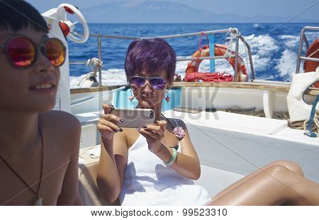 Mother & Son On Boat