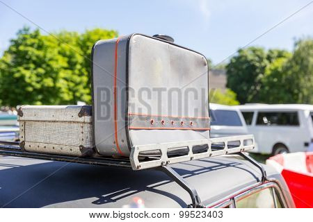 Suitcases on the car top