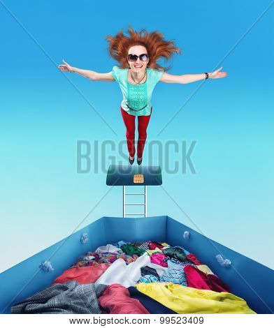Woman flying to the heap of clothes