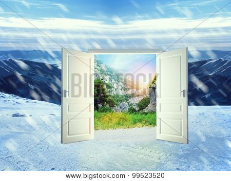 Door in winter mountains