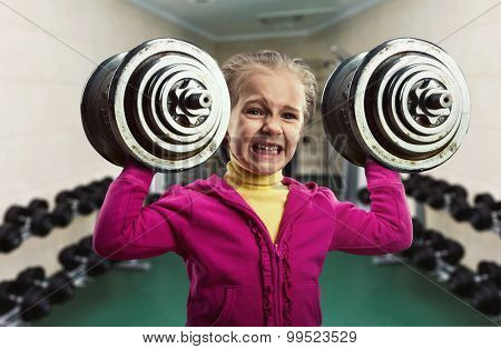 Little girl with dumb-bells