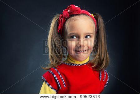 Little girl looking aside