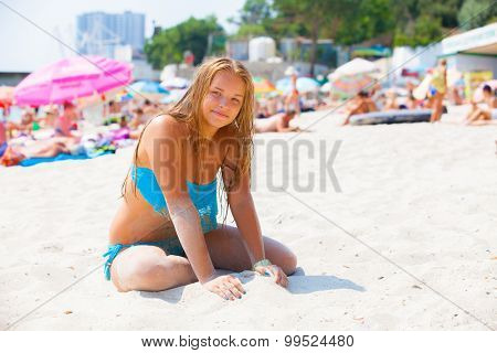 beautiful girl  in a swimsuit on the beach