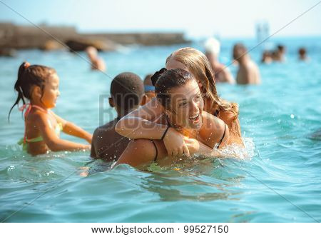 Happy family playing on sea