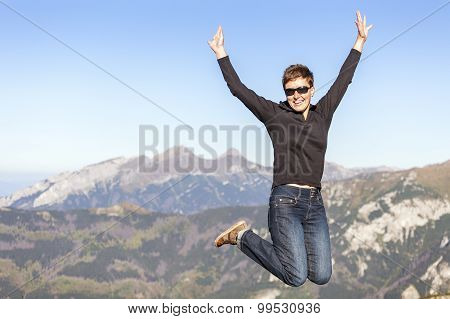Happy Jumping Tourist In The Mountains