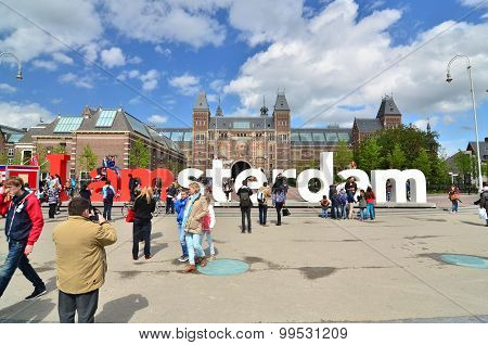 Amsterdam, Netherlands - May 6, 2015: Tourists At The Famous Sign
