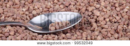 Buckwheat Background And Teaspoon