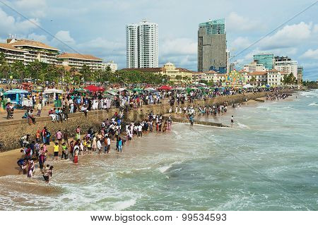 People relax at the seaside in Colombo, Sri Lanka.