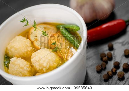 Delicious portion of cream soup with crackers