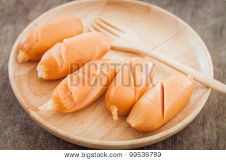 Chicken Sausages On Wooden Plate