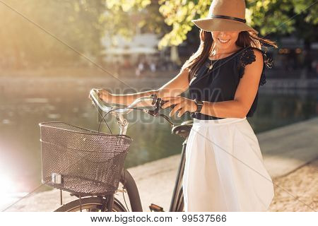 Happy Woman At The Park With A Bike