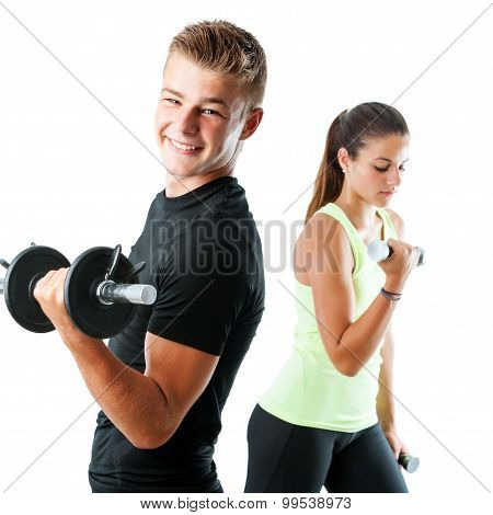 Handsome Teen Couple Working Out With Weights.
