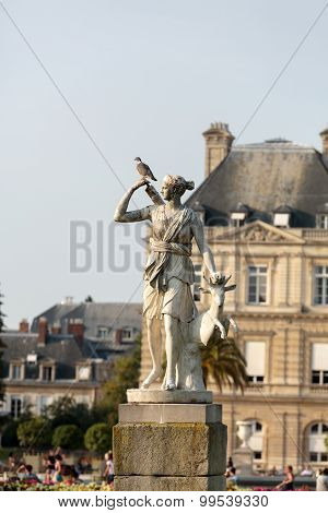 PARIS, FRANCE - SEPTEMBER 8, 2014: Luxembourg Garden in Paris. Luxembourg Palace is the official residence of the French Senate.