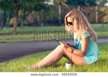 Beautiful girl with tablet in his hands.