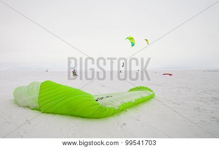 Kiteboarder with kite on the snow
