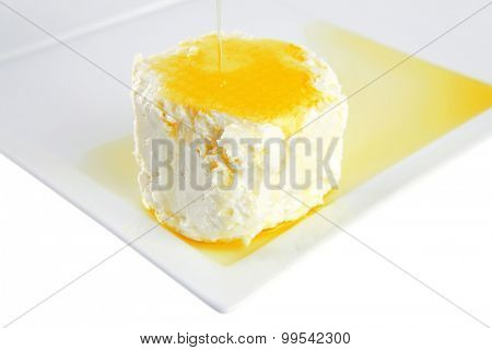 whole soft cheese on white with olive oil