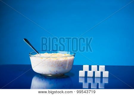Bowl Of Cereals With Milk And Sugar